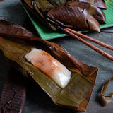 Vietnamese food, banh nam, banh bot loc. Vietnamese food, a special street food from Hue cuisine, make from rice flour with meat, shrimp, pack with banana leaf Royalty Free Stock Images