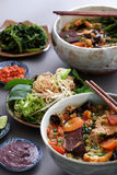 Vietnamese food, bun rieu and canh bun. Is popular street food cook from crab, tofu, vermicelli eat with shrimp paste, vegetables, is delicious and cheap dish Stock Photo