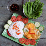 Vietnamese food, cooked rice, omelet, Valentine day. Idea for Valentine day meal, cooked rice, omelet in heart shape, tomato, cucumber,bean for nutrition eating Royalty Free Stock Images