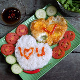 Vietnamese food, cooked rice, omelet, Valentine day. Idea for Valentine day meal, cooked rice, omelet in heart shape, tomato, cucumber,bean for nutrition eating Royalty Free Stock Photography