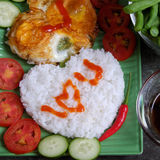Vietnamese food, cooked rice, omelet, Valentine day. Idea for Valentine day meal, cooked rice, omelet in heart shape, tomato, cucumber,bean for nutrition eating Stock Photos