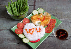 Vietnamese food, cooked rice, omelet, Valentine day. Idea for Valentine day meal, cooked rice, omelet in heart shape, tomato, cucumber,bean for nutrition eating Stock Photography