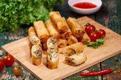 Vietnamese food. Delicious homemade spring rolls on wooden table stock photos