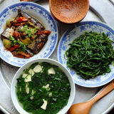 Vietnamese food, family meal, Dinner time. Vietnamese food, fish sauce, boiled vegetable and vegetables soup.Dinner time is family meal and happy time, a Stock Images