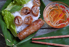 Vietnamese food, spring roll, bun,cha gio. Vietnamese food, spring roll or cha gio, a delicious fried food with cylinder shape, eat with bun, salad and fish stock photos