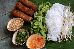 Vietnamese food, spring roll, bun,cha gio. Vietnamese food, spring roll or cha gio, a delicious fried food with cylinder shape, eat with bun, salad and fish royalty free stock photography