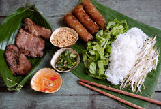Vietnamese food, spring roll, cha gio, roast meat. Vietnamese food, spring roll or cha gio, roast meat , a delicious fried food, eat with bun, salad and fish stock photos