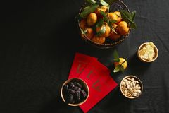Vietnamese food for Tet holiday in spring, jam is traditional food on lunar new year. Text on envelop means Happy New Year and Happiness royalty free stock photos