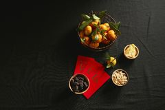 Vietnamese food for Tet holiday in spring, jam is traditional food on lunar new year. Text on envelop means Happy New Year and Happiness stock image
