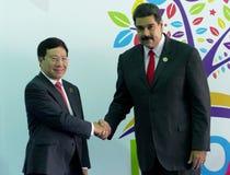 Vietnamese Foreign Minister Pham Binh Minh and Venezuelan President Nicolas Maduro Royalty Free Stock Images