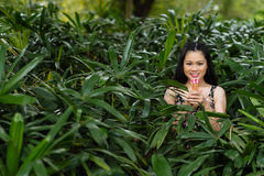 Vietnamese girl in bushes Royalty Free Stock Photos