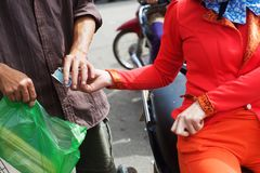 Vietnamese girl buys goods Stock Photos
