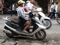 Vietnamese girl on the motorbike Royalty Free Stock Images