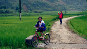 Vietnamese girl riding bicycle on track Royalty Free Stock Images