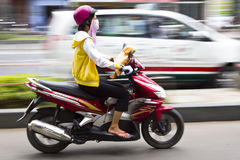 Vietnamese girl riding motorcycle in Vietnam Stock Photos