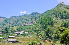 Vietnamese hill tribe village. Minority village and modern building on top of mountain in Sapa, Vietnam stock images