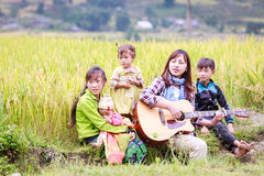 Vietnamese Hmong children in rice terrace river side o at Y TY town. LAO CAI, VIETNAM - OCT 23: Vietnamese Hmong children in rice terrace river side o at Y TY Stock Images