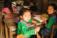 Vietnamese Hmong children in the rural school. Sapa, Vietnam - April 14, 2016: Vietnamese school children in the rural junior classroom. Education in the small Royalty Free Stock Photography