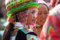 Vietnamese Hmong minority girl trying new traditional costume Royalty Free Stock Image
