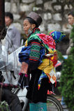 Vietnamese Hmong woman carrying her child Royalty Free Stock Images
