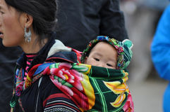 Vietnamese Hmong woman carrying her child Royalty Free Stock Photography