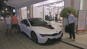 Luxury BMW in Ho Chi Minh city. Vietnamese in Ho Chi Minh city gather in front of the hotel Rex to see expansive cars. Hotel Rex is one of the favourite spots of stock video