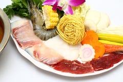 Vietnamese hot pot of shrimp, beef, fresh fish, corn, mushroom, royalty free stock photos