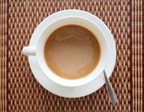 Vietnamese instant hot coffee top view on exotic Asian mat Royalty Free Stock Image