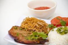 Vietnamese Keuken - Geroosterde Varkenskotelet met Rijst Stock Afbeeldingen