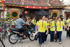 Vietnamese kids leaving class. HO CHI MINH, VIETNAM, FEBRUARY 24 , 2015: Vietnamese students in Chinese language are leaving school at the Ong Bon Pagoda, in Stock Photo