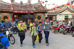 Vietnamese kids leaving class. HO CHI MINH, VIETNAM, FEBRUARY 24 , 2015: Vietnamese students in Chinese language are leaving school at the Ong Bon Pagoda, in Stock Images