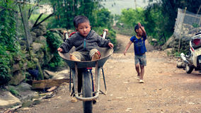 Vietnamese kids playing on street in Sa Pa. Vietnamese kids playing on the street in Sa Pa Valley in Vietnam royalty free stock photo