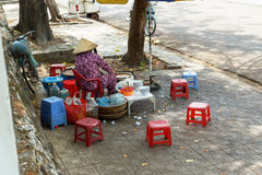Vietnamese laday sale local food on pavement Royalty Free Stock Images