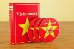 Vietnamese language textbook with flag of Vietnam and CD discs o. N the wooden table. 3D Royalty Free Stock Photos
