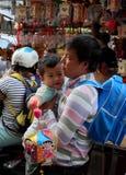 Vietnamese lantern street,  mid autumn festival. HO CHI MINH CITY, VIET NAM- SEPT 13, 2016: Vietnamese father visit lantern street to buy lanterns for kid on mid Stock Photo