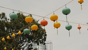 Vietnamese lanterns hanging in the afternoon on the Ho Chi Minh Street. stock footage