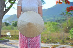 Vietnamese long dress with traditional leaf hat Stock Image
