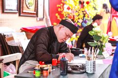 Vietnamese lunar year festival scholar. This is a tradition of the Vietnamese lunar new year. stock photos