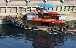 Vietnamese man anchorage boat polluted water Royalty Free Stock Photo