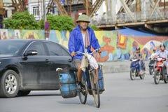 Vietnamese man on a bike Royalty Free Stock Photos