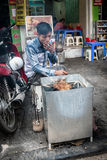 Vietnamese man cooking on the street Stock Image