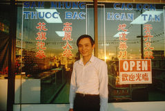 A Vietnamese man in front of a restaurant Royalty Free Stock Photography