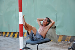 Vietnamese man resting in the shadow stock images