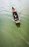 Vietnamese man rides the boat Stock Photos