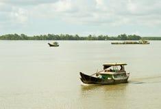Vietnamese man rides a boat Stock Image