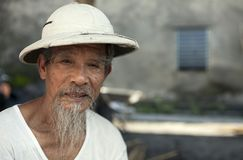 Vietnamese Man Wearing a Pith Helmet. North Vietnamese man with a goatee beard wearing a traditional white pith helmet in Bac Ninh province, Vietnam Stock Images