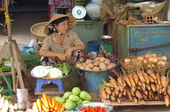Vendor at Vietnamese street market Royalty Free Stock Image