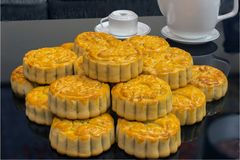 Vietnamese mid autumn festival cake. Mooncakes are traditional pastries eaten during the Mid-Autumn Festival. The festival involve. S family getting together to Stock Photo