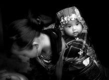 Vietnamese moeder en baby stock foto