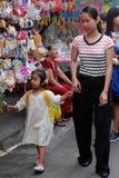 Vietnamese mom and daughter visit lantern street Royalty Free Stock Image